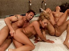 Mind blowing foursome XXX with two naked milfs