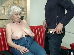 Horny senior madam Norma seduced say no to neighbor and fucked him on the couch