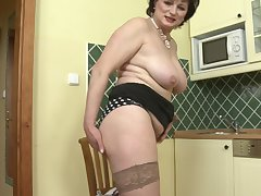 Mature Dalia plays with her pussy and her favorite dildo in her kitchen