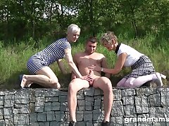 Lucky dude talked several babes into playing up his cock outdoors