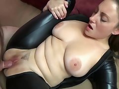 Busty housewife Melanie Hicks fucks in her black catsuit