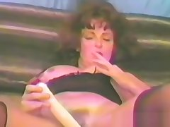 Doyen Brunette Fucks Both The brush Holes With Dildos